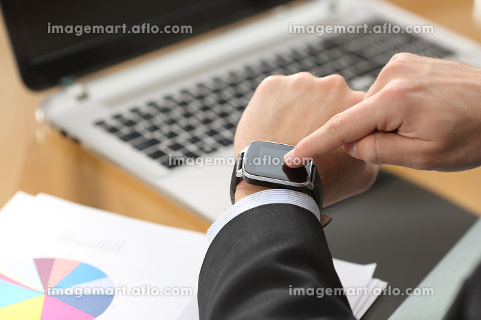 Businessman using a smart watch at office