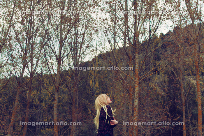Young blond woman alone in nature