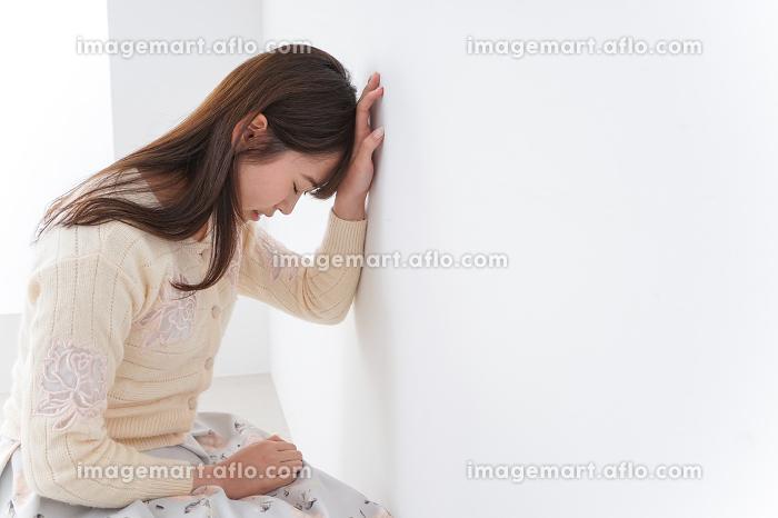 体調不良の女性