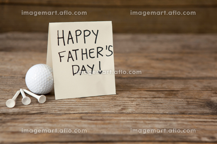 Fathers day greeting card by golf ball on tableの販売画像