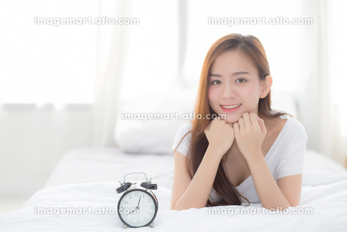 Beautiful of portrait young asian woman wake up in morning and aの販売画像