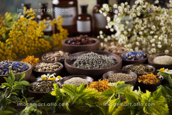 Herbs medicine and vintage wooden desk background