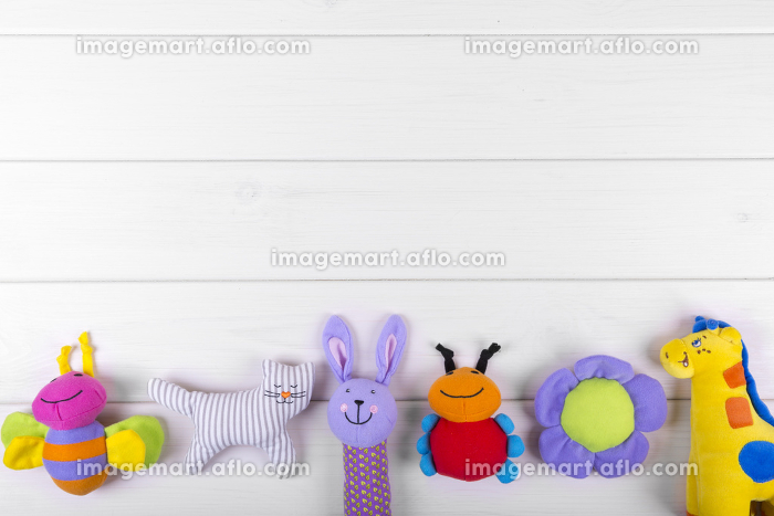stuffed baby toys on wooden background with copy spaceの販売画像