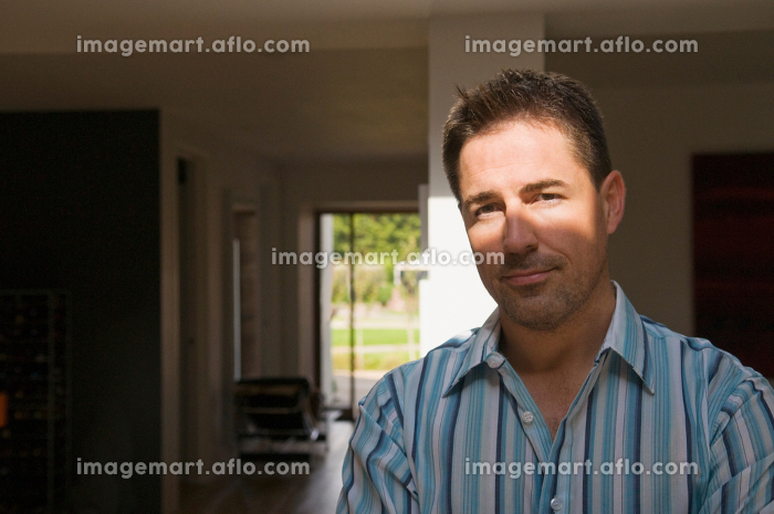A portrait of a man in shaded light