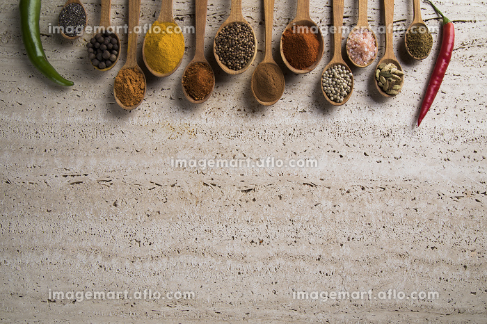 Assortment of spices in wooden bowl backgroundの販売画像