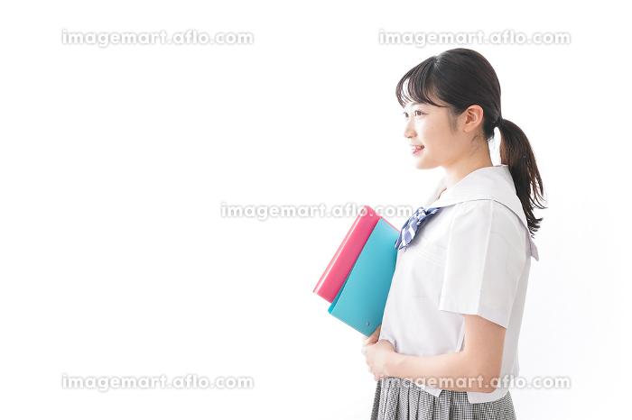 制服を着た笑顔の女子高校生の販売画像