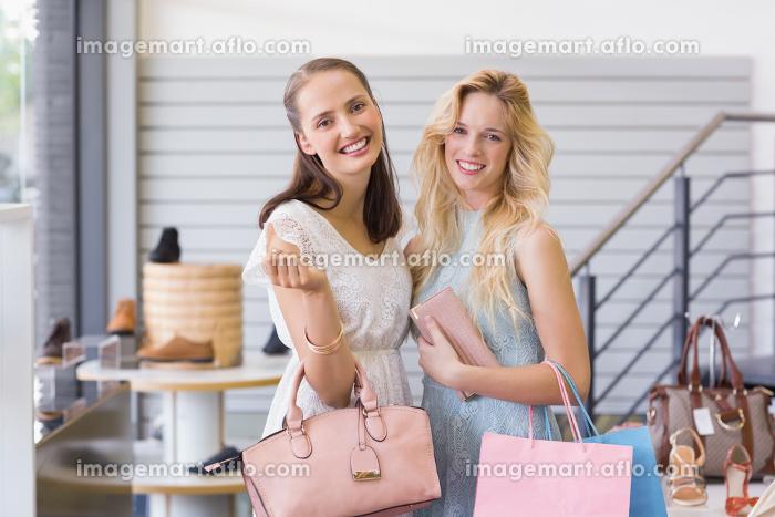 Two beautiful women smiling at cameraの販売画像