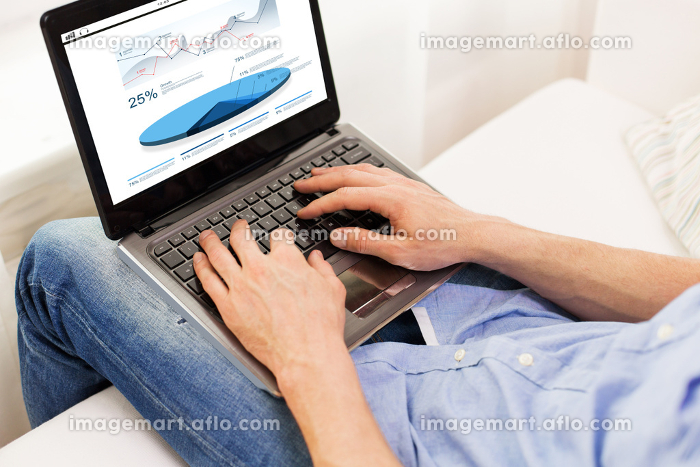 close up of man typing on laptop computer at home