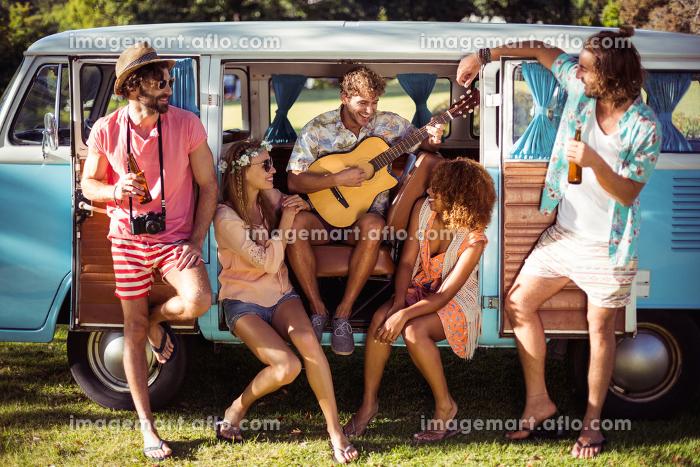 Group of friends having fun at music festivalの販売画像