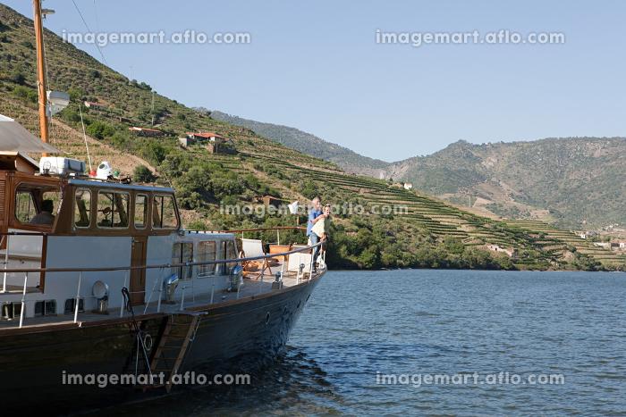 Senior couple on holiday on boatの販売画像