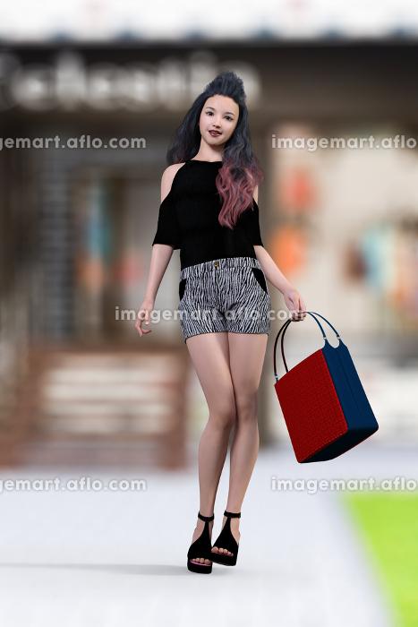 大きなカバンを持ち黒髪ロングの女性が黒い肩の出たトップスとゼブラ柄のショートパンツを履き歩いている