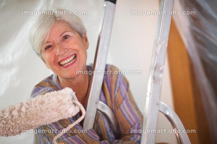 Mature woman doing DIY