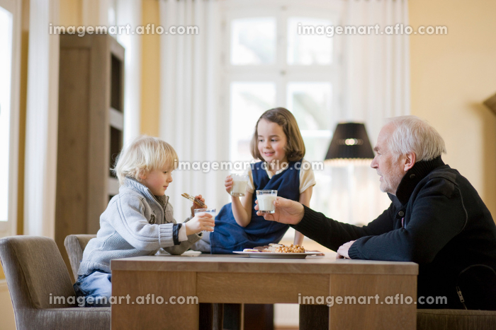 grandfather and grandchildren eating