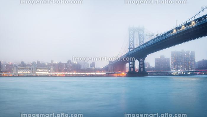 Manhattan bridge and Manhattan at foggy evening