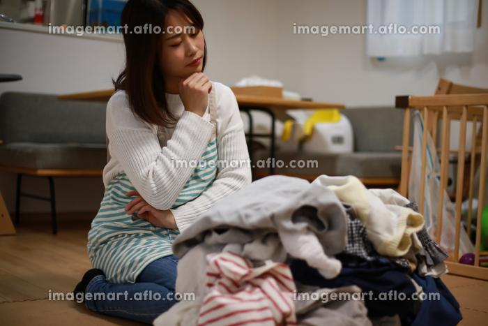 家事に疲れた女性の販売画像
