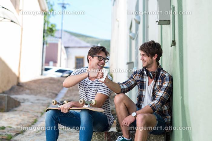 Hip men sitting on steps