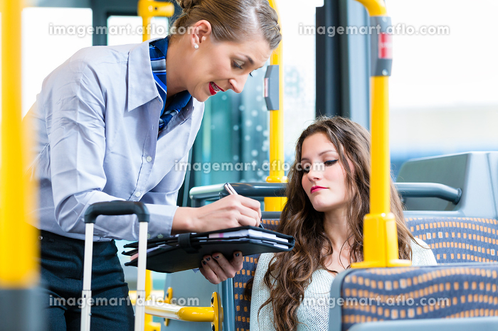 Woman in bus having no valid ticket at inspectionの販売画像