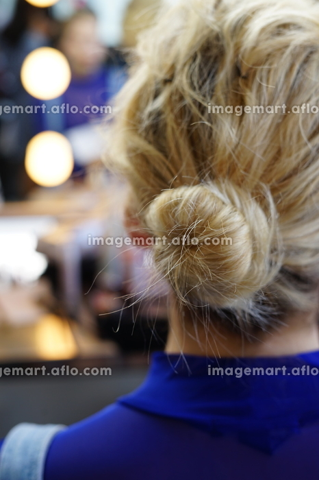 young woman with stray hairs and a messy bun hairstyleの販売画像