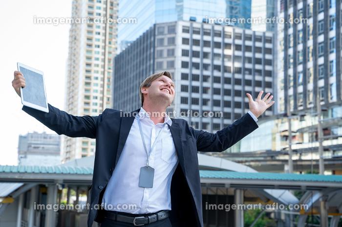 Cheerful Businessman Celebrating Success at City. , Bangkok, Bangkok, Thailandの販売画像