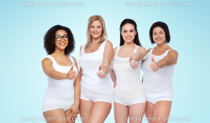 group of happy different women showing thumbs upの販売画像